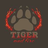 Tiger footprint and fire on dark background. For tshirt - vector illustration Stock Photo