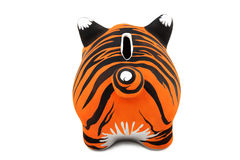 Tiger fur. The skin of a tiger, is drawn on a Piggy Bank Royalty Free Stock Photography