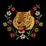 Tiger head and colorful flowers embroidery artwork design Stock Photo