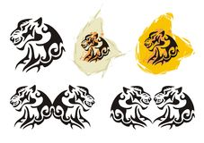 Tiger head symbols in tribal style. Set of the majestic tigers heads on a white background Royalty Free Stock Photos