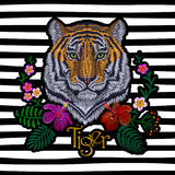 Tiger head tropic flower. Front view embroidery patch sticker. Orange striped black wild animal stitch texture textile print. Jung Royalty Free Stock Image