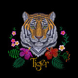 Tiger head tropic flower. Front view embroidery patch sticker. Orange striped black wild animal stitch texture textile print. Jung Royalty Free Stock Photos