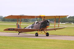 Tiger moth military biplane runway Stock Photo