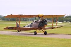 Tiger moth military biplane runway stock photo