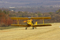 Tiger Moth landing. On a bush strip in Africa after sight seeing flight Stock Images