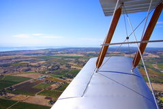 Tiger Moth Over Adelaide. Photograph taken from a vintage Tiger-Moth Biplane looking down onto the Gulf St Vincent & Adelaide's Southern suburbs & farmland ( stock images