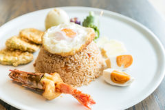 Tiger prawn fried rice. With fried egg and salt egg Stock Image
