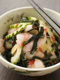 Tiger Prawn Wakame and Cucumber Salad with Ginger. Bowl of Tiger Prawn Wakame and Cucumber Salad with Ginger Royalty Free Stock Photos