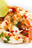 Tiger Prawns with Lime Coriander and Chili. Tiger prawns with lime, coriander and red chili Stock Image