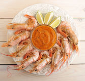Tiger prawns with pesto and slices of lime Stock Image