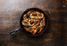 Tiger prawns roasted on frying grill pan Royalty Free Stock Images