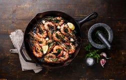 Tiger prawns shrimps on frying pan Stock Photos