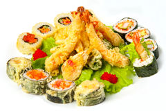 Tiger prawns in tempura and hot rolls with lettuce leaves Royalty Free Stock Images