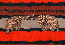 Tiger print fabric. Tiger print with african background fabric stock photo