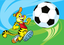 Tiger runs a soccer ball. On abstract action background Royalty Free Stock Images