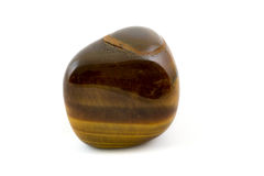 Tiger's eye adorable gemstone close up white background Royalty Free Stock Photo