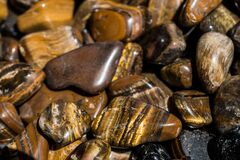 Free Tiger`s Eye And Hawk`s Eye Gemstone As  Mineral Rock Royalty Free Stock Photos - 194237748