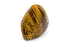 Tiger's eye beautiful gemstone close up white background Stock Photography