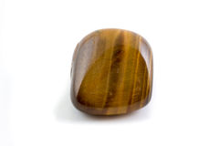 Tiger's eye gemstone close up white background Stock Photo