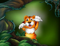 A tiger in a scary forest Royalty Free Stock Image