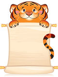 Tiger with scroll. Tiger - symbol of approaching new 2010 year. Illustration with a copyspace Royalty Free Stock Photo