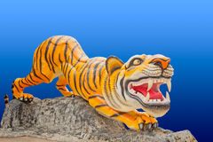 Tiger sculpture on blue background Royalty Free Stock Images