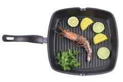 Tiger shrimp on black pan. Stock Photos