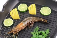 Tiger shrimp on black pan. Stock Photo