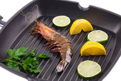 Tiger shrimp on black pan. Stock Photo