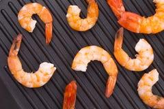 Tiger shrimps on black pan. Stock Photo