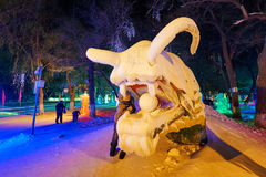 The tiger snow sculpture and boy. The photo was taken in Zhaolin park Harbin city Heilongjiang province,China stock photography