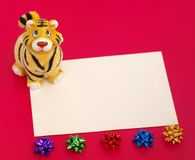 Tiger statuette and blank on red Royalty Free Stock Images