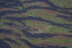 Tiger stripe camouflage fabric texture. Background stock photos
