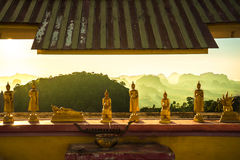 Tiger temple buddhas. Buddhas with a view in the tiger temple in krabi - thailand Royalty Free Stock Image