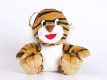 Tiger toy. A small tiger toy on the white background Stock Photo