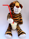 Tiger Toy Drinking Milk Royalty Free Stock Photos