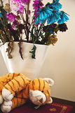 Tiger soft toy wilting flowers Stock Images