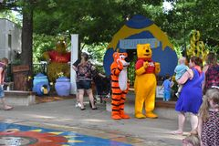 Tiger and Winnie The Pooh at the Park Royalty Free Stock Photography