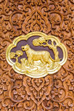 Tiger wood Carving Wall sculptures in thai temple Stock Photography