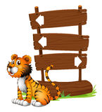 A tiger beside a wooden signboard Stock Photo