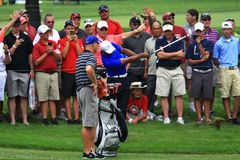 Tiger Woods hits near the crowd Stock Photo
