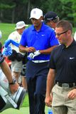 Tiger woods and Sean Foley. Tiger woods walks to the next hole with Sean Foley his hitting coach and golf instructor at the PGA professional golf tournament Stock Photo