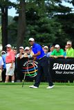 Tiger Woods watches his drive. Tiger Woods looks down the fairway after making a hit at the PGA professional golf tournament event, Northeast Ohio, United States Royalty Free Stock Photography