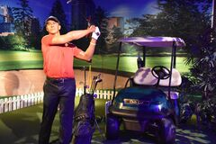 Tiger Woods wax statue at Madame Tussauds Wax Museum at ICON Park in Orlando, Florida