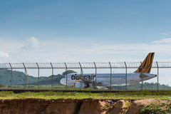 Tigerair airline taxi for depature behind fence Royalty Free Stock Image