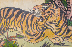 Tigermålning på granitväggen Fotografering för Bildbyråer