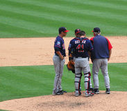 Tigers game July 11 2010,  mound conference. DETROIT, MI - JULY 11: Minnesota Twins players hold a conference at the mound during their game against the Detroit Stock Images