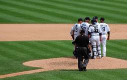 Tigers game July 11 2010, mound conference. DETROIT, MI - JULY 11: Detroit Tigers players hold a conference at the mound during their loss to the Minnesota Twins Royalty Free Stock Photography