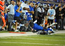 Tigers Wide Receiver Kedarius Jones dives for a pass. Memphis Tigers Wide Receiver Kedarius Jones dives for a pass in a 44 to 31 win over the Southern Illinois Stock Images