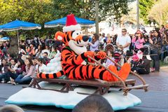 Tigger (Winnie the Pooh's friend) rides a sleigh in Disneyland Parade Stock Photo